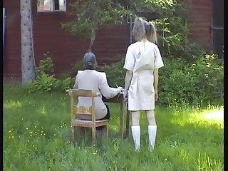 Stern grandmother spanks granddaughter