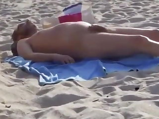 Beach Daddy has a wet dream while sleeping on the beach